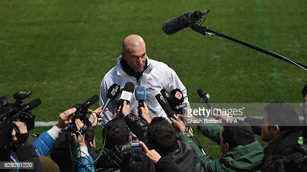 Real Madrid coach Zinedine Zidane talks in the mixed zone before a training session at Mitsuzawa Football Stadium on December 12, 2016 in Yokohama,...