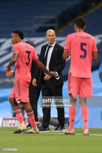 Real Madrid coach Zinedine Zidane winks during the UEFA Champions League round of 16 second leg match between Manchester City and Real Madrid at...
