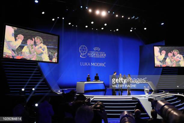 Real Madrid Croatian midfielder Luka Modric receives the UEFA Champions League Midfielder of the Season during the draw for UEFA Champions League...