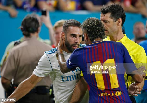 Real Madrid defender Daniel Carvajal argues with Barcelona forward Neymar after a play during the first half of the ''El Clasico Miami''...