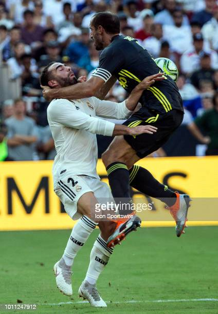 Real Madrid defender Daniel Carvajal clashes with Juventus defender Giorgio Chiellini during an International Champions Cup match between Juventus...