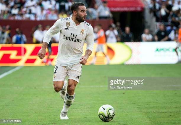 Real Madrid defender Daniel Carvajal moves the ball upfield during an International Champions Cup match between Juventus and Real Madrid on August 4...