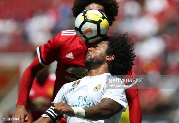 Real Madrid defender Marcelo Da Silva Junior heads the ball during the first half of the International Champions Cup match between Manchester United...