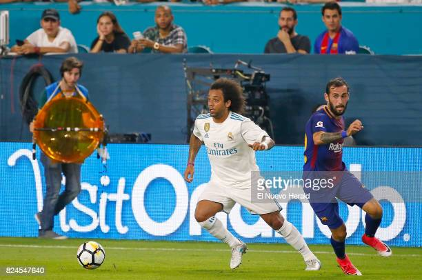 Real Madrid defender Marcelo vies with Barcelona defender Aleix Vidal during the first half of the ''El Clasico Miami'' BarcelonaReal Madrid match as...