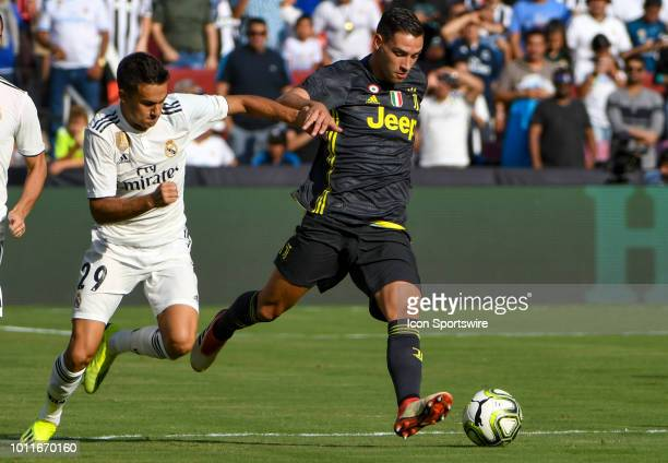 Real Madrid defender Sergio Reguilon and Juventus forward Nicolo Fagioli fight for a ball during an International Champions Cup match between Real...