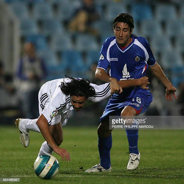 Real Madrid defender Spaniard Alvaro Mejia vies with Getafe midfielder Spaniard Pablo Redondo during their Liga football match in Getafe 14 October...