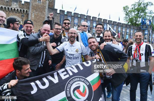 Real Madrid fan enjoys the city centre atmosphere with Juventus fans prior to the UEFA Champions League Final between Juventus and Real Madrid on...