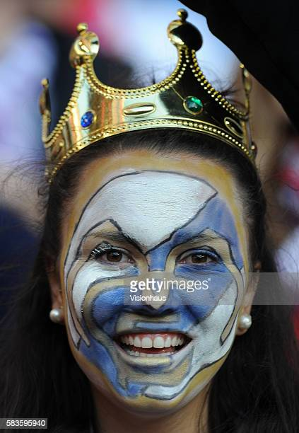 Real Madrid fan wearing a crown with face painted with the Real Madrid badge during the UEFA Champions League Final between Real Madrid and Atletico...