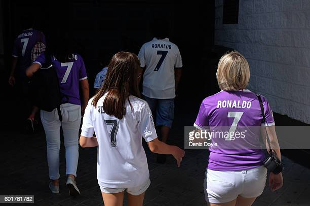 Real Madrid fans arrive at the estadio Santiago Bernabeu ahead of the La Liga match between Real Madrid CF and CA Osasuna at Estadio Santiago...