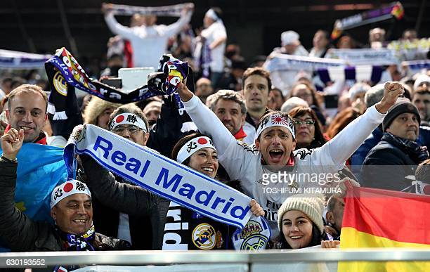 Real Madrid fans celebrate after they won the Club World Cup football final match between Kashima Antlers of Japan and Real Madrid of Spain at...