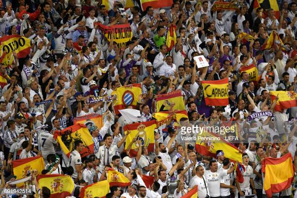 Real Madrid fans celebrate during the UEFA Champions League Final between Juventus and Real Madrid at National Stadium of Wales on June 3 2017 in...
