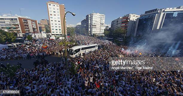 Real Madrid fans cheer the arrival of the players bus prior to the UEFA Champions League quarterfinal second leg match between Real Madrid CF and...