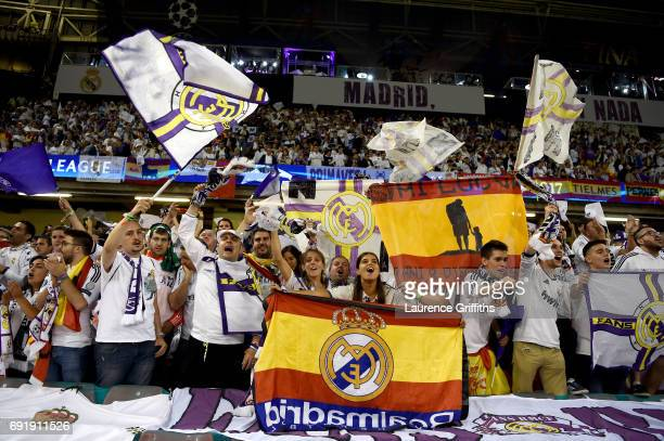 Real Madrid fans display banners and flags prior to the UEFA Champions League Final between Juventus and Real Madrid at National Stadium of Wales on...