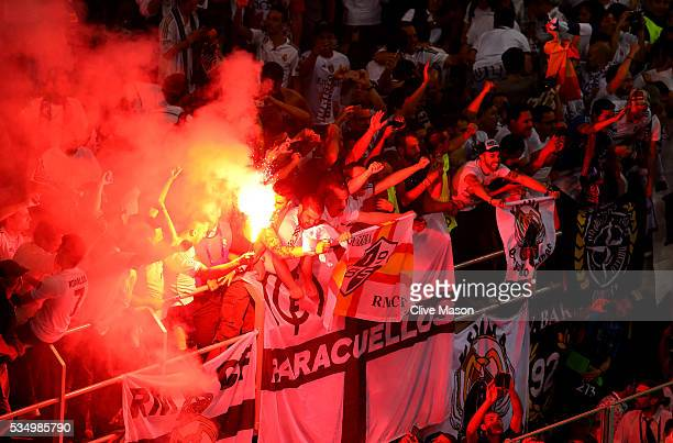 Real Madrid fans let off a flare as they celebrates after the UEFA Champions League Final match between Real Madrid and Club Atletico de Madrid at...