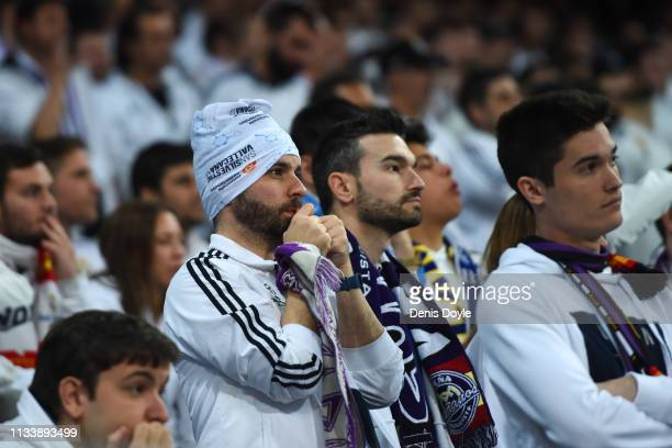 Real Madrid fans look dejected during the UEFA Champions League Round of 16 Second Leg match between Real Madrid and Ajax at Bernabeu on March 05...
