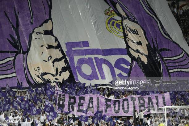 Real Madrid fans open a banner during the UEFA Champions League round of 16 first leg soccer match between Real Madrid and Manchester City at...