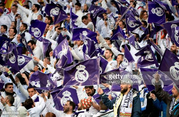 Real Madrid fans wave flags before the UEFA Champions League quarterfinal second leg football match between Real Madrid CF and Juventus FC at the...