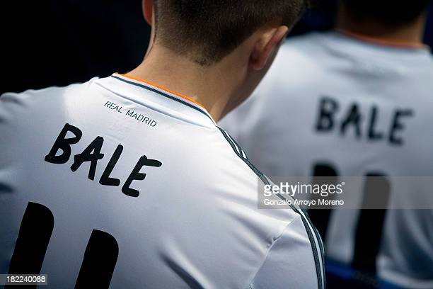 Real Madrid fans wear Gareth Bale jerseys prior to the start of the La Liga match between Real Madrid CF and Club Atletico de Madrid at Estadio...
