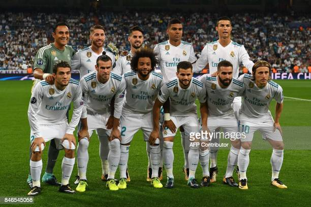 Real Madrid FC's players line up before the UEFA Champions League football match Real Madrid CF vs APOEL FC at the Santiago Bernabeu stadium in...