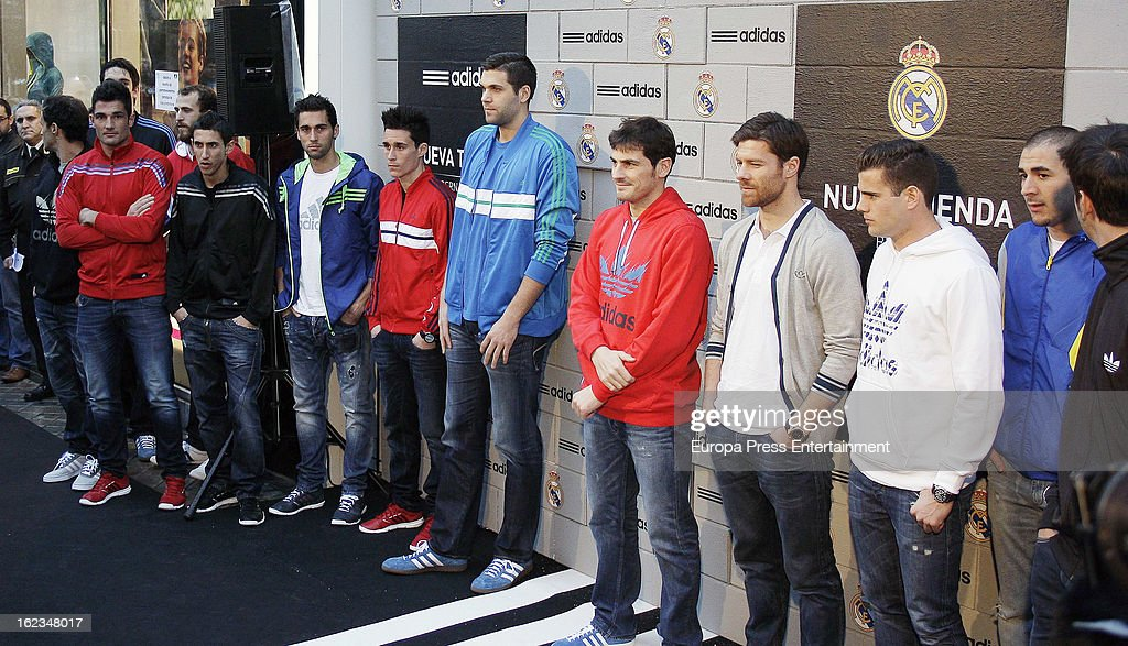 Real Madrid football and basketball players (2L-R) Angel Di Maria, Alvaro Arbeloa, Jose Callejon, Felipe Reyes, Iker Casillas, Xabi Alonso, Nacho Fernandez and Karim Benzema attend the opening of the new 'Adidas' store at the Santiago Bernabeu stadium on February 21, 2013 in Madrid, Spain.