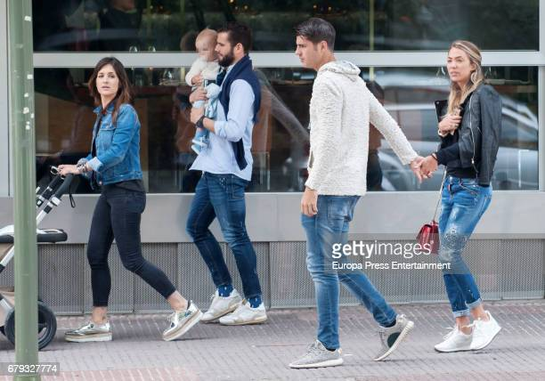 Part of this image has been pixellated to obscure the identity of the child Real Madrid football player Alvaro Morata and his girlfriend Alice...