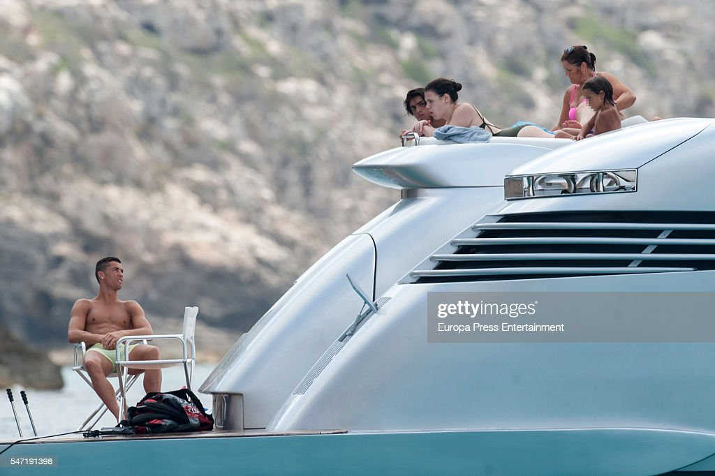 . Real Madrid football player Cristiano Ronaldo (L) and his mother Maria Dolores dos Santos Aveiro (R) are seen on July 13, 2016 in Ibiza, Spain.