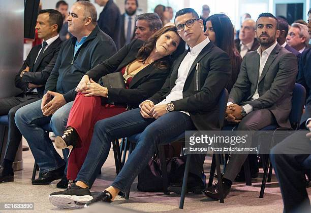 Real Madrid football player Cristiano Ronaldo is joined by his mother Maria Dolores dos Santos Aveiro his agent Jorge Mendez following his press...