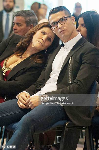 Real Madrid football player Cristiano Ronaldo is joined by his mother Maria Dolores dos Santos Aveiro following his press conference after signing a...