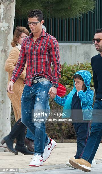 Real Madrid football player Cristiano Ronaldo is seen picking up his son Cristiano Ronaldo jr from school on January 30 2015 in Madrid Spain