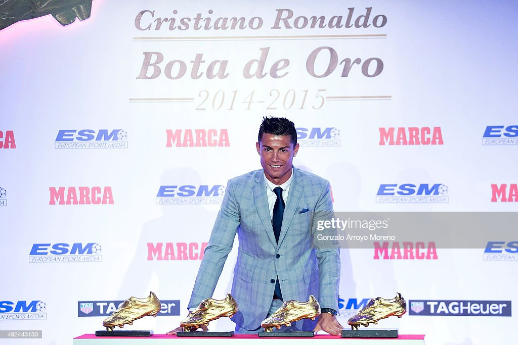 Real Madrid football player Cristiano Ronaldo poses with his four Golden Boot Awards as maximun goal scorer of European leagues at The Westin Palace Hotel on October 13, 2015 in Madrid, Spain.