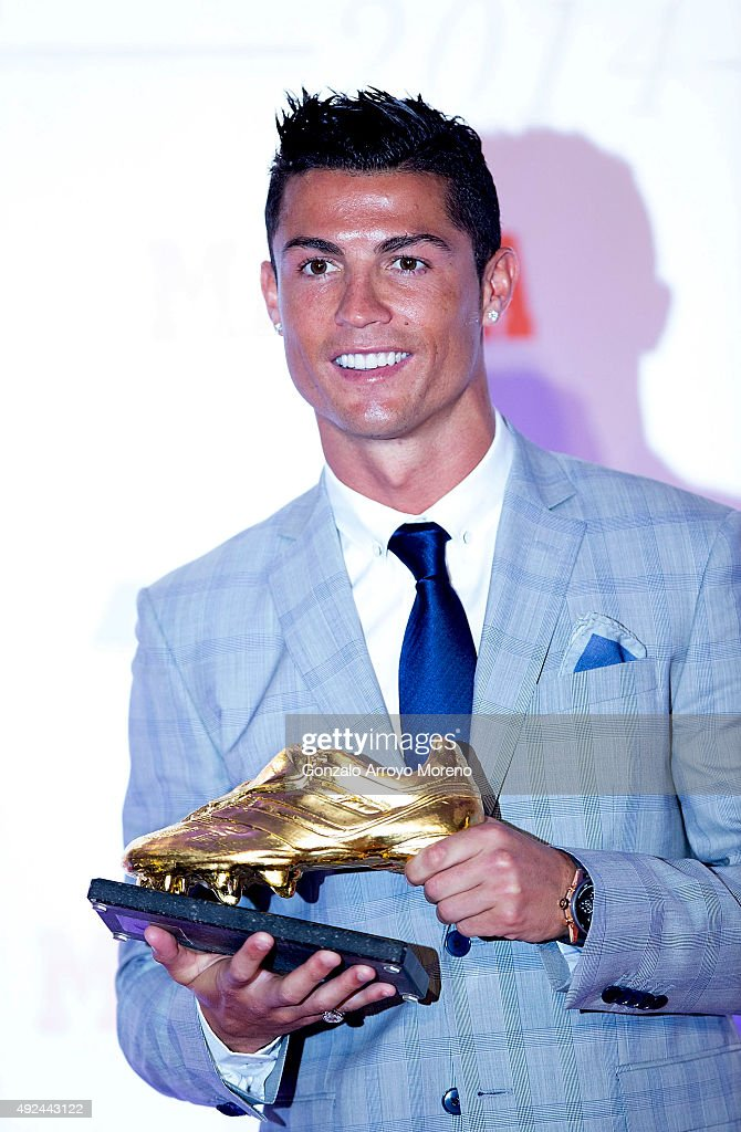 Real Madrid football player Cristiano Ronaldo poses with his fourth Golden Boot Award as maximun goal scorer of European leagues at The Westin Palace Hotel on October 13, 2015 in Madrid, Spain.