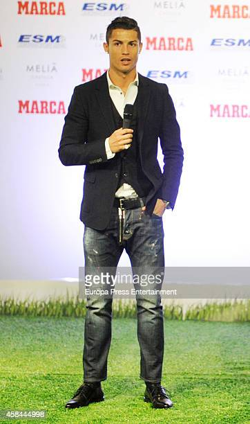 Real Madrid football player Cristiano Ronaldo receives the '20132014 Golden Boot' Award on November 5 2014 in Madrid Spain