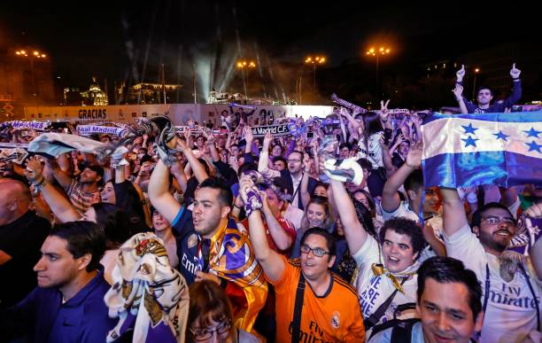 cb1e85f11 Real Madrid football team fans celebrate the team's win on Plaza Cibeles in  Madrid on May ...
