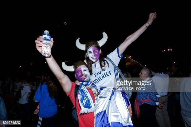 Real Madrid football team fans celebrate the team's win on Plaza Cibeles in Madrid on June 3 2017 after the UEFA Champions League football match...