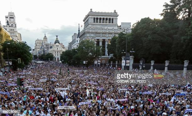 Real Madrid football team fans celebrate the team's win on Plaza Cibeles in Madrid on June 4 2017 after the UEFA Champions League football match...