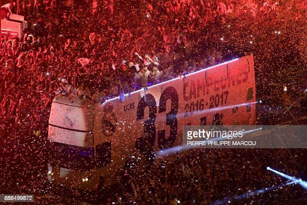 TOPSHOT Real Madrid football team fans surround the bus as Real Madrid celebrate the team's win on Plaza Cibeles in Madrid on May 22 2017 after the...