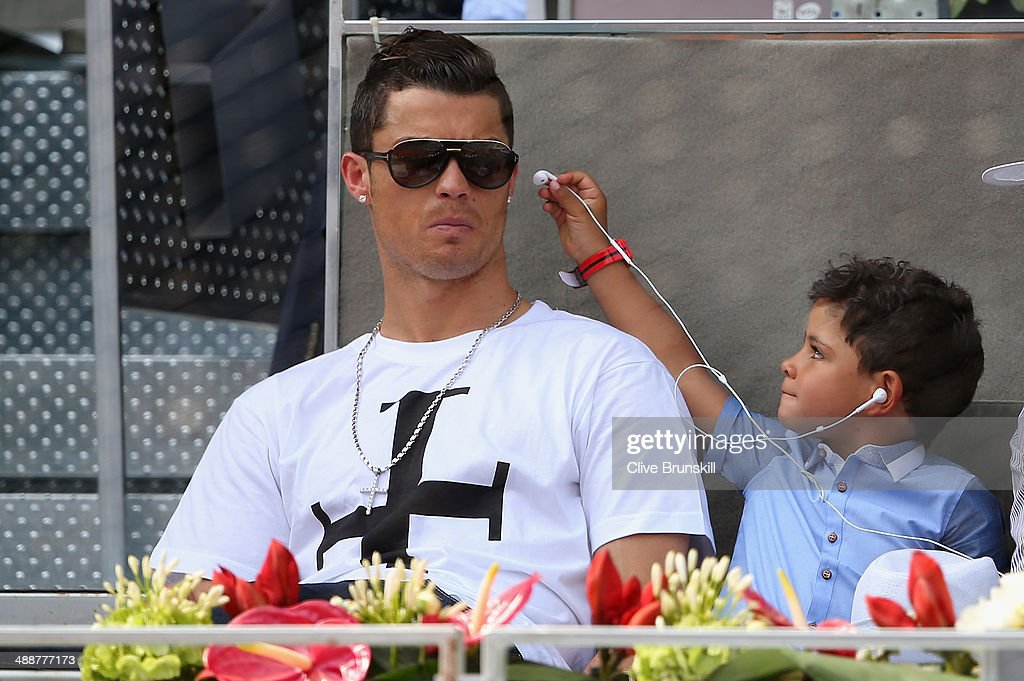 Real Madrid footballer Cristiano Ronaldo and his son Cristiano Ronaldo Junior watch Rafael Nadal of Spain against Jarkko Nieminen of Finland in their third round match during day six of the Mutua Madrid Open tennis tournament at the Caja Magica on May 8, 2014 in Madrid, Spain.
