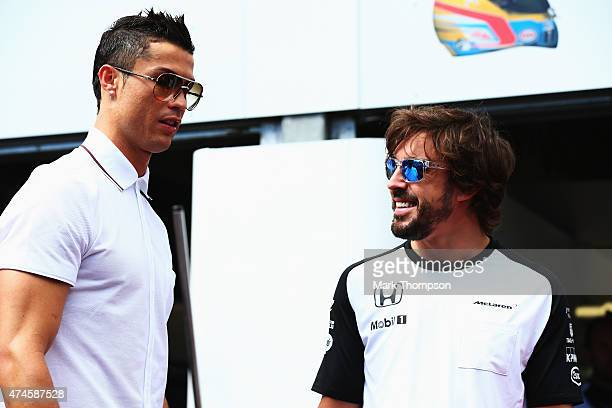 Real Madrid footballer Cristiano Ronaldo meets Fernando Alonso of Spain and McLaren Honda in the pitlane before the Monaco Formula One Grand Prix at...