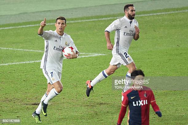 Real Madrid forward Cristiano Ronaldo celebrates his goal in a penalty kick during the Club World Cup football final match between Kashima Antlers of...