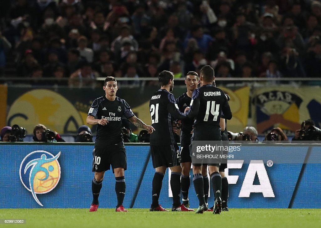 Real Madrid forward Cristiano Ronaldo (3rd L) celebrates with his teammates after their second goal during the Club World Cup semi-final football match between Club America of Mexico and Real Madrid of Spain at Yokohama International stadium in Yokohama on December 15, 2016. / AFP / Behrouz MEHRI