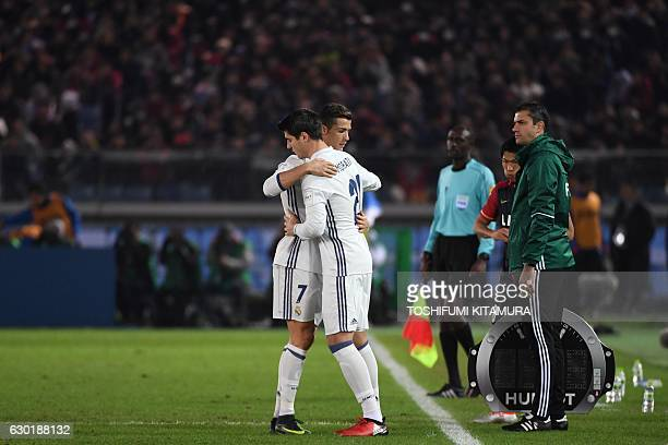 Real Madrid forward Cristiano Ronaldo embraces Real Madrid forward Alvaro Morata after Ronaldo is substituted following his third goal in the match...