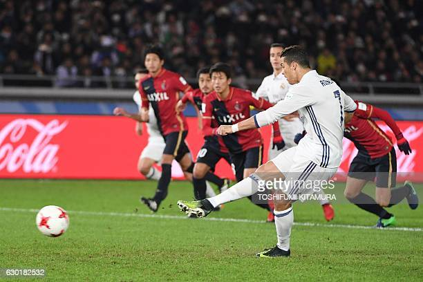 Real Madrid forward Cristiano Ronaldo scores a penalty during the Club World Cup football final match between Kashima Antlers of Japan and Real...
