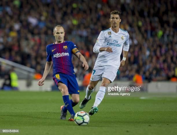 Real Madrid forward Cristiano Ronaldo vies with Barcelona's midfielder Andres Initesa during the Spanish league football match between FC Barcelona...