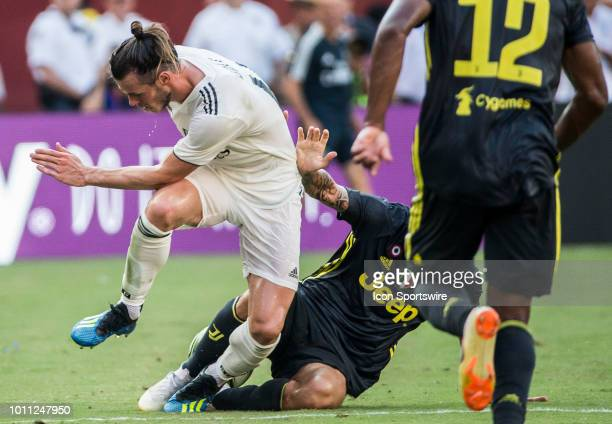 Real Madrid forward Gareth Bale loses the ball to Juventus defender Giorgio Chiellini during an International Champions Cup match between Juventus...