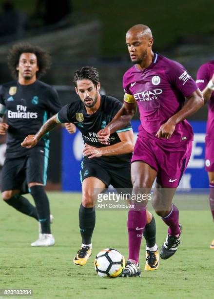 Real Madrid forward Karim Benzema drives the ball past Manchester City defender Danilo during their International Champions Cup football match on...
