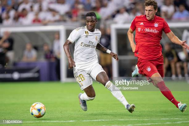 Real Madrid forward Vinicius Junior dribbles up field as Bayern Munich defender Benjamin Pavard defends during the International Champions Cup soccer...