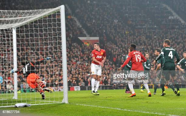 Real Madrid goalkeeper Diego Lopez makes a save from Manchester United's Danny Welbeck