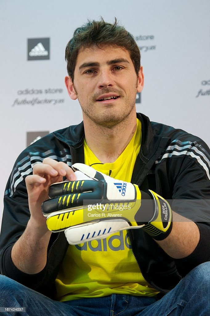 Real Madrid goalkeeper Iker Casillas (L) present the new boots Adidas Predator at the Adidas Parque Sur store on April 25, 2013 in Madrid, Spain.