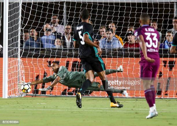 Real Madrid goalkeeper Keylor Navas makes a save against Manchester City during their International Champions Cup football match on July 26 2017 at...