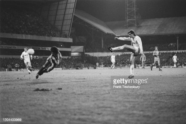 Real Madrid goalkeeper Miguel Angel dives as British footballer Glenn Hoddle shoots for Tottenham Hotspur during their UEFA Cup Quarter Final, First...